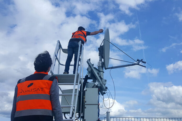 Quadsat technicians taking measurement from antenna with new technology