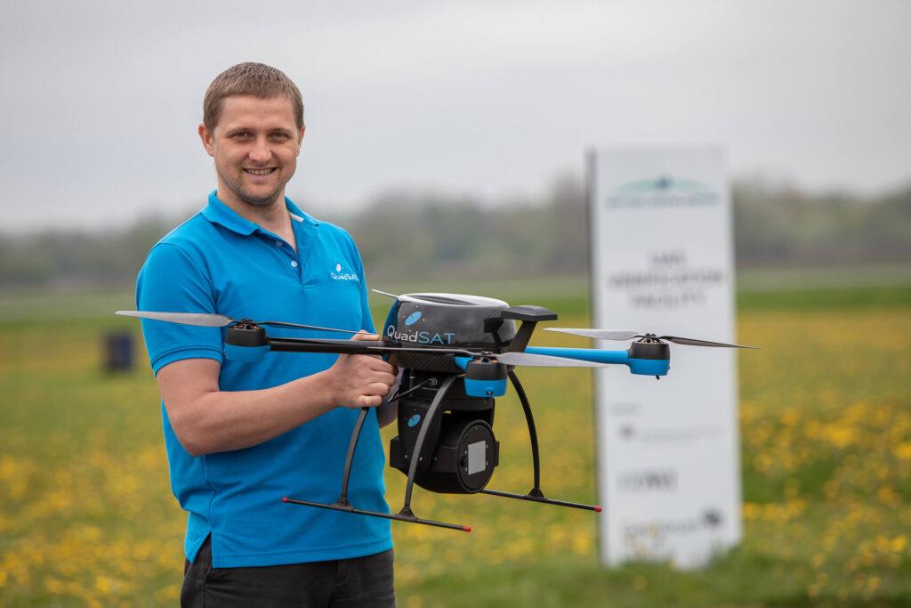 Vitalie holding drone for demonstration